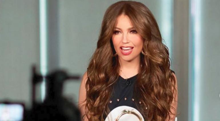 Revelan la identidad del cantautor que le hizo el feo a Thalía