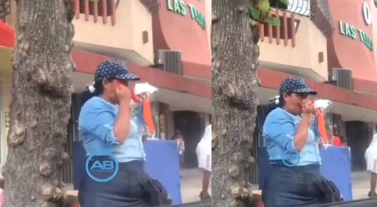 Mujer se limpia la nariz con los tapabocas que vende